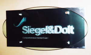 Business office sandblasted sign on stand-off mounting by Glass Graphics of Atlanta.