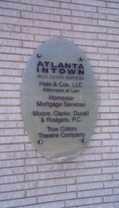 Exterior business office glass sign on stand-off mounting by Glass Graphics of Atlanta.