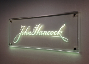 Carved glass office sign mounted on stand-offs by Glass Graphics of Atlanta.