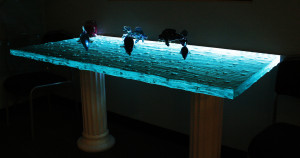 Textured glass table top with color-changing LED illumination by Glass Graphics of Atlanta.