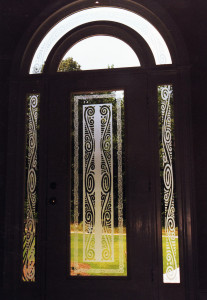 Sandblasted glass graphics in residential front door, side lights, and transom by Glass Graphics of Atlanta.