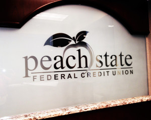 Sandblasted or frosted interior glass signage for an office by Glass Graphics of Atlanta.