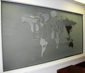 Sandblasted or frosted interior glass signage for and office by Glass Graphics of Atlanta.