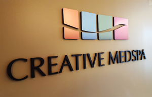 Corporate logo on dimensional letter sign by Glass Graphics of Atlanta.