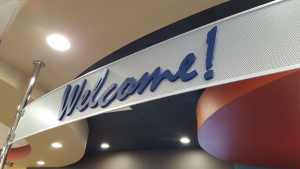 Corporate greeting / slogan on dimensional letter sign by Glass Graphics of Atlanta.