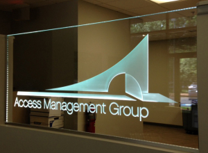 Carved commercial logo in glass panel with LED-illumination. All by Glass Graphics of Atlanta
