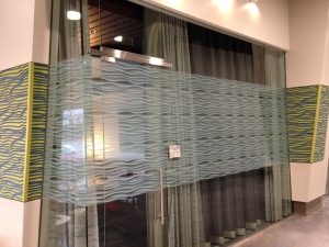 Printed graphic on film applied to glass office partition. All by Glass Graphics of Atlanta.