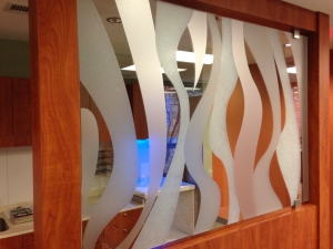 Graphic on film applied to glass office partition. All by Glass Graphics of Atlanta.