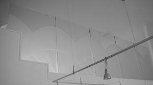 Carved graphic on glass architectural partition by Glass Graphics of Atlanta.