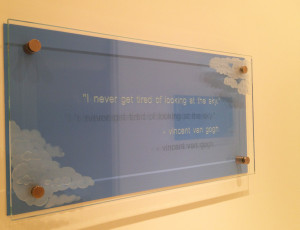 Sandblasted glass graphic sign on stand-off mounting by Glass Graphics of Atlanta.