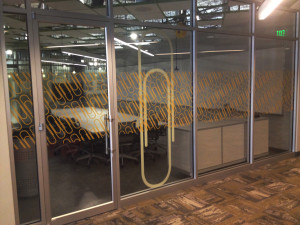 Filmed glass office partition and door by Glass Graphics of Atlanta.