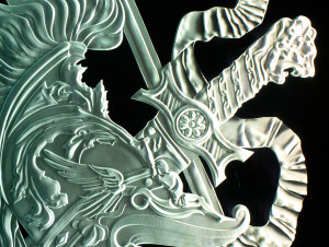 Detailed carving of crest in glass by Glass Graphics of Atlanta.