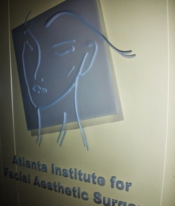 Medical office glass feature with glass carving by Glass Graphics of Atlanta.