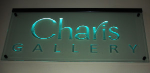 Business office sandblasted sign on stand-off mounting and LED-lighted by Glass Graphics of Atlanta.