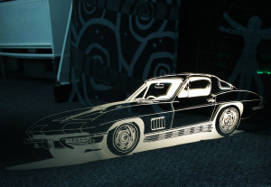 Lighted sandblasted image of a corvette in a glass panel by Glass Graphics of Atlanta.