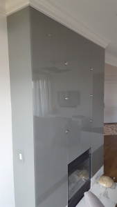 Painted glass paneling surrounding residential fireplace by Glass Graphics of Atlanta.