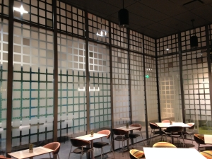 Printed graphic on film applied to glass dining room partition. All by Glass Graphics of Atlanta.