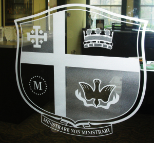 Sandblasted glass institutional logo on glass office door by Glass Graphics of Atlanta.