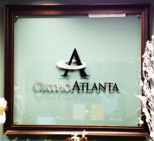 Interior dimensional letter sign for an office on glass mounted on stand-offs by Glass Graphics of Atlanta.