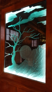 Moon and tree glass carving by Glass Graphics of Atlanta.