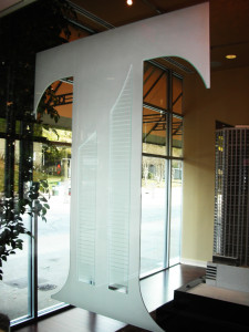 Office glass partition with glass carving created and installed by Glass Graphics of Atlanta.