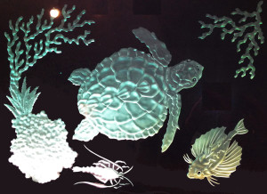 Glass carving under-sea scene by Glass Graphics of Atlanta.