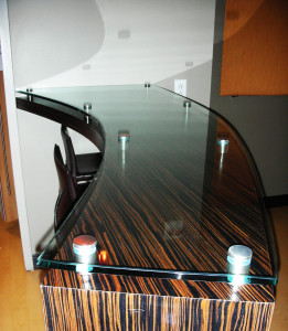 Glass counter top mounted on stand-offs by Glass Graphics of Atlanta.
