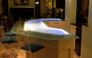 Sandblasted / frosted glass counter top with color-changing LED-illumination created and installed by Glass Graphics of Atlanta.