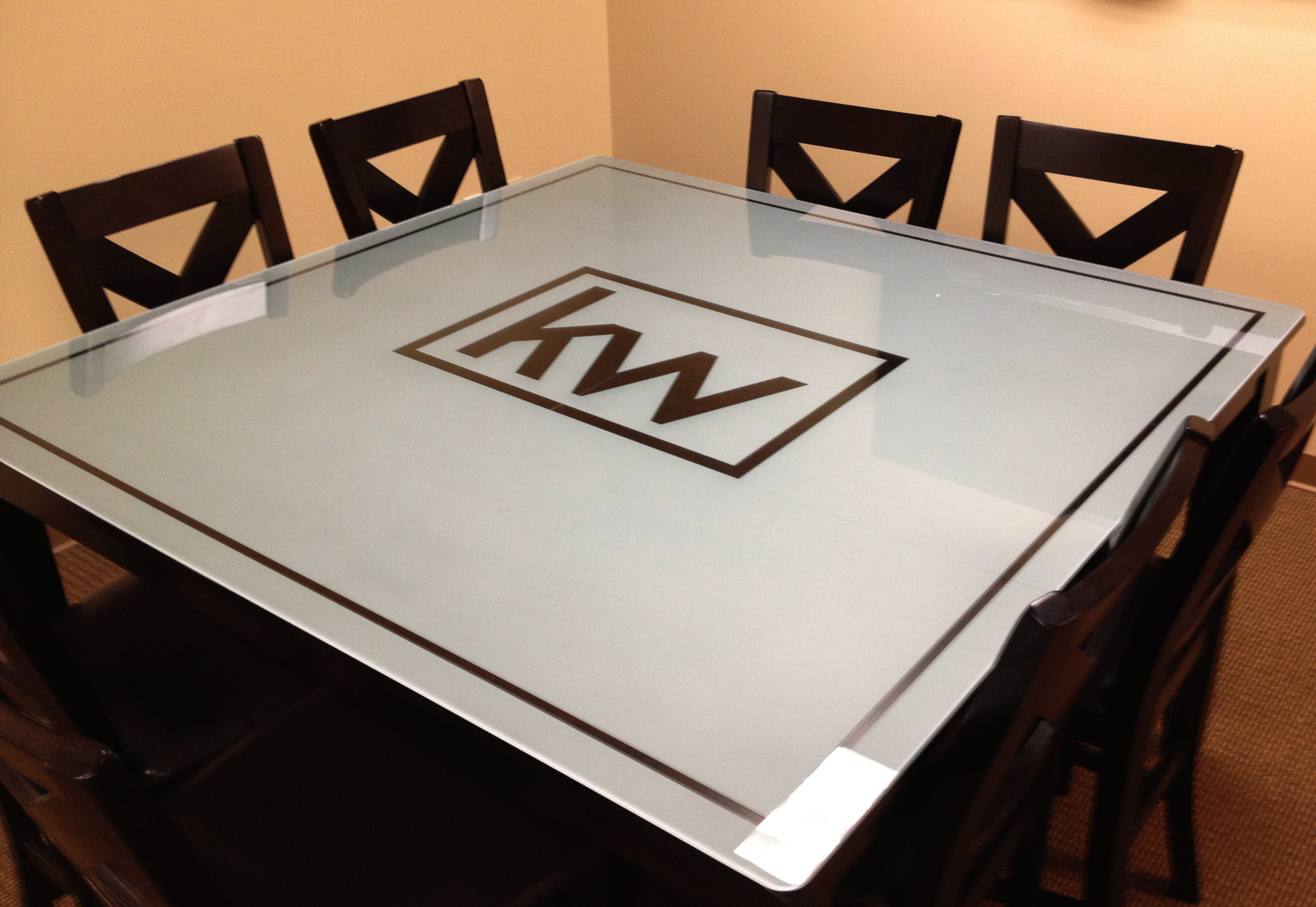 Sandblasted or frosted glass conference room table top by Glass Graphics of Atlanta.
