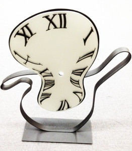 Sandblasted surrealist glass clock by Glass Graphics of Atlanta.