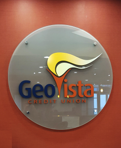 Dimensional letter corporate logo sign on glass panel mounted on stand-offs by Glass Graphics of Atlanta.