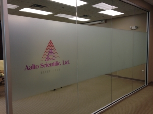 Printed corporate logo with graphic on film applied to glass office partition. All by Glass Graphics of Atlanta.